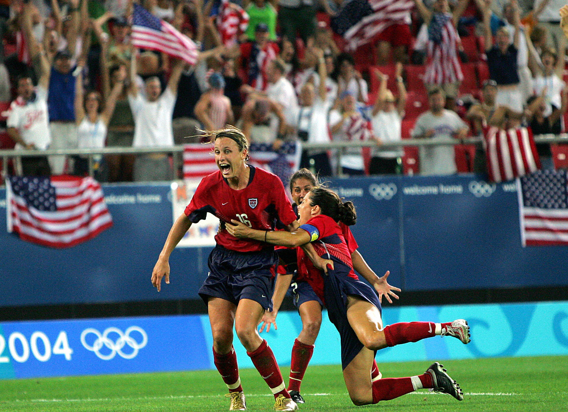 US forward Abby Wambach and her teammate
